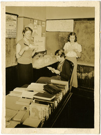 Three young women in Fairhaven High School classroom
