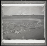 Panoramic aerial view of the Bellinham waterfront and downtown with snow-covered Mt. Baker and the Twin Sisters in the distance