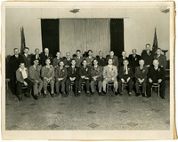 Group of twenty five unidentified men at a conference