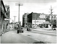 Northerly view of Fairhaven district's 12th Street with Fairhaven Hotel on right side of road in center of photograph, Bellngham, Washington