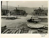 Shipbuilding drydock scene with several boats under construction