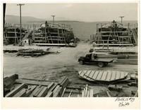 Shipbuilding drydock scene with several boats under construction