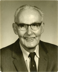 Studio portrait of smiling older man in spectacles