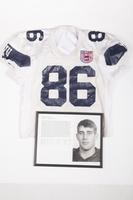 Football Jersey and Photograph: Jersey #86 and photograph of Chris Nicholl, Wide Reciever, list of honors and records, 1993/1996