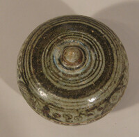 Sawankhalok ware lidded box with iron brown design of floral scrolls on body and lid
