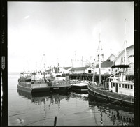 View of boats and buildings on a pier