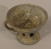 Cup with handle with five rectangular slots in stem