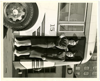 Two unidentified women in uniform stand in the doorway of bus #15 in front of the Leopold Hotel in Bellingham.