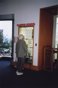 2007 Reunion--Mollie (McCush) Della Terza Examines One Of The Library Displays