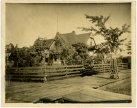 J.J. Donovan's house at 13th and McKenzie Streets - exterior of home and fenced yard with boardwalk