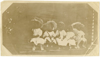 Five unidentified young girls with parasols sit in a row