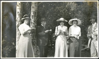 Five peple share a laugh at a garden party