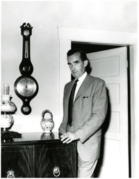 Edward R. Murrow standing in his mother's house, Bellingham, Washington