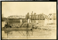 Scow derrick on Skagit River with log float and bridge in background