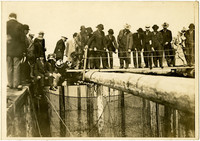 "People from the ""Falcon"" getting a closer look at the fishtrap."