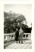Man and woman pose on marble patio of a landmark or memorial in Washington, D.C.