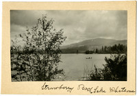 Two people in rowboat at Strawberry Bay on Lake Whatcom