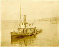 """Fishtrap tender """"Mountaineer"""" with docks in background"""