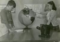 1943 Students Studying Using Globe