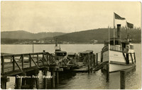 """Several early-model automobiles ascend the ramp from Deception Pass ferry dock with moored passenger ferry """"Clatawa"""""""