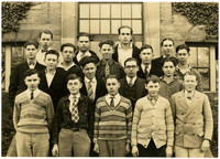 Fairhaven High School boys pose in rows on steps of school