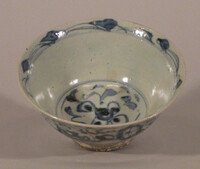 Blue bowl decorated with floral scrolls