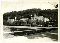 Old Main building at Western Washington State College, with Sehome Arboretum in background