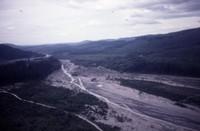 Aerial views of debris-chocked stream, location unknown.