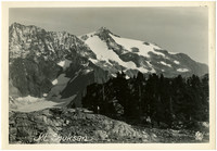 Mount Shuksan with glaciers, with forested alpine ridge in foreground