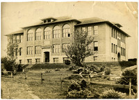 Front exterior of brick, three-story, unidentified high school building