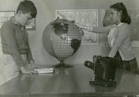 1943 Students Studying Using Globe