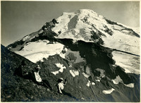 Three hikers sit on alpine slope with Mount Baker and its glaciers in background