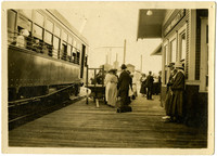 Sedro Woolley Train Station - several men and women stand on platform with rail car.