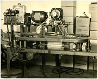An unidentified machine used in the salmon processing, possibly part of the boning process or box-making process