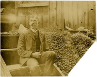 Man seated on exterior stairs