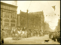 Seattle procession of horse-drawn wagons with Smith Butchering Machines