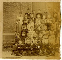 School children posing in front of school