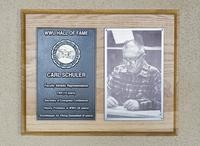 Hall of Fame Plaque: Carl Schuler, Faculty Athletic Representative, Class of 1997