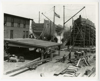 Pacific American Fisheries shipyard in south Bellingham, WA, with two ships under construction next to warehouse