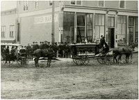 Horse-drawn wagon with coffin in funeral procession in front of Denver Market