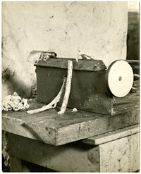 """Crude-looking machine on table used as """"boning device"""" for salmon porcessing"""