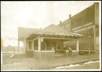 Man and two boys stand on porch of south Bellingham terminal for Interurban electric railroad