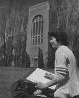 1950 Student drawing outside Library