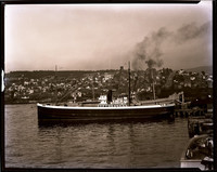 """Pacific American Fisheries' steamship """"Oakwood"""" docked in south Bellingham with South Hill neighborhood in background"""