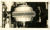 "Close-up view of ""sliming brush"" machinery"