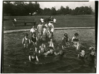 Twelve unidentified young girls and two young boys in a shallow pool, perhaps at Fairhaven Park