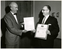 A.W. Talbot, owner of Bellingham Shipyards receives an award certificate