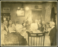 Fourteen men and women seated around a dinig table.