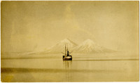 Steamship on Alaskan waters with Pavlof volcano in distance