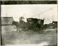 Horse-drawn wagon hauling split wood near Cornwall Street dock